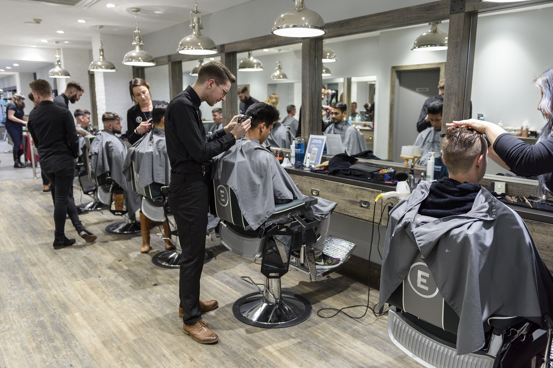 Old Barber Chairs >> Everyman barbers toast 10 years with new salons and a hip new look.